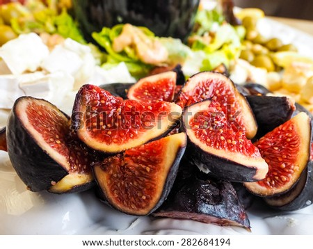 Delicious ripe  figs in fruit salad, ready to serve. - stock photo