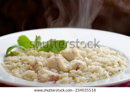 Delicious risotto with seafood  - stock photo