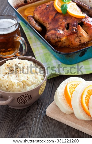 Delicious roasted duck with oranges and beer in a pan, rustic style