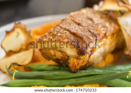 Delicious roasted pork belly with crackling, sweet potato mash and steamed green beans.