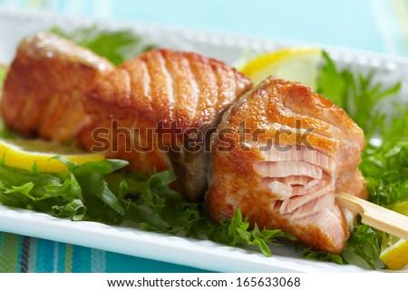 Delicious roasted salmon on skewers - stock photo