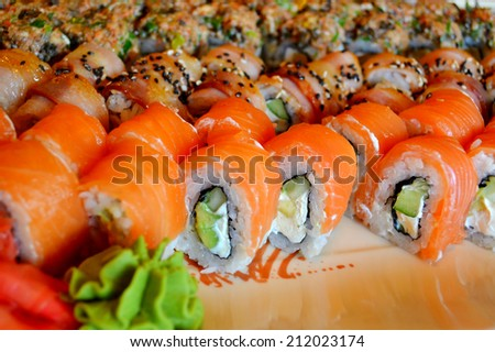 Delicious rolls and sushi with eel, salmon and philadelphia - stock photo