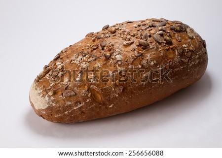 Delicious rye bread, sprinkled with pumpkin seeds - stock photo