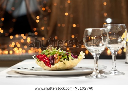 delicious salad and two spare glasses - stock photo