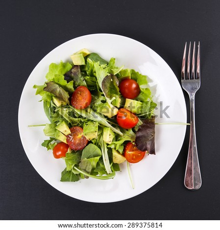 Delicious salad on the table - stock photo
