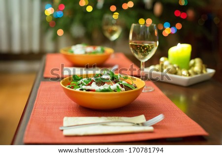 Delicious salad served for two - stock photo
