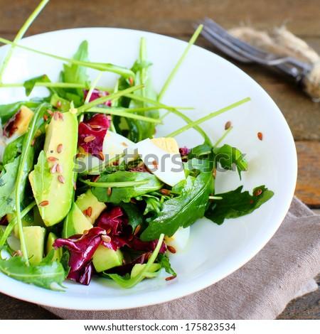 delicious salad with avocado, food closeup - stock photo