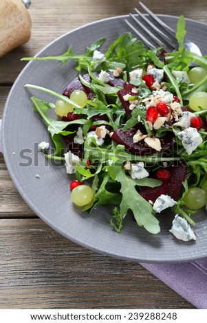 Delicious salad with beetroot on plate, tasty food - stock photo