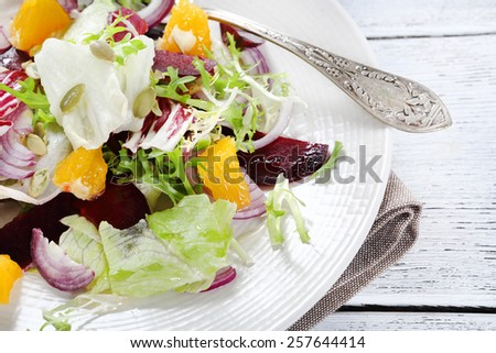 Delicious salad with fruit on a plate, food - stock photo