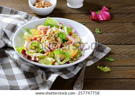 Delicious salad with fruit on a plate, vegetarian food - stock photo