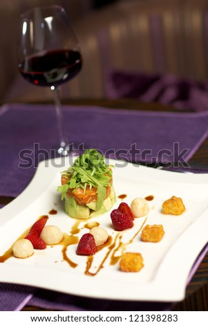 delicious salad with fruits and vine
