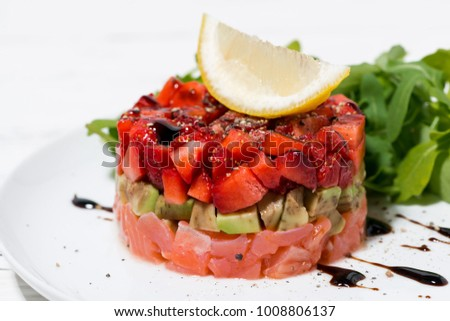 delicious salad with salted fish and avocado, closeup horizontal