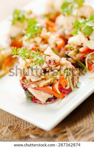 Delicious salads with shrimps on white plate - stock photo