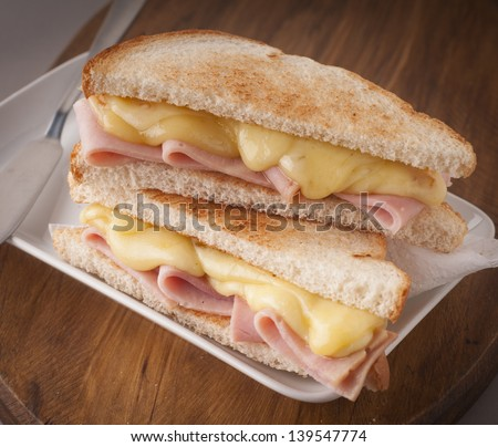delicious sandwich of ham and melted cheese - stock photo