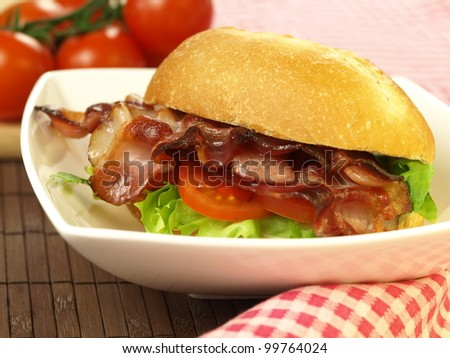 Delicious sandwich with bacon for a dinner - stock photo