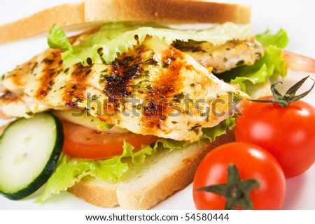 Delicious sandwich with grilled chicken meat and vegetables