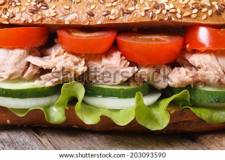 Delicious sandwich with tuna and vegetables on an old table macro. horizontal   - stock photo