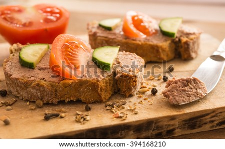 Delicious sandwiches made from liver pate on wooden background - stock photo