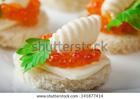 Delicious sandwiches with caviar, close-up - stock photo