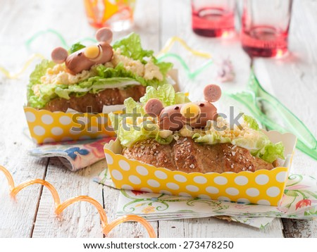 Delicious sandwiches with sausage like a bear for kids party, selective focus - stock photo