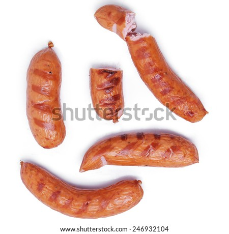Delicious sausages on a white background