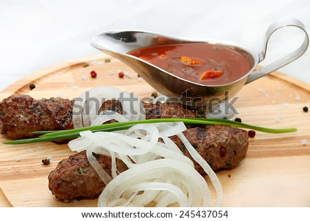 Delicious sausages on wooden background - stock photo