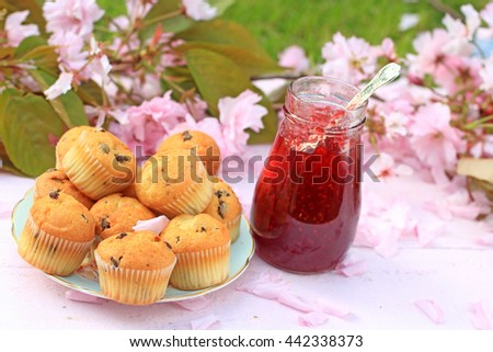 Delicious Scottish, muffins on a wooden pink table, fresh breakfast in the Spring garden