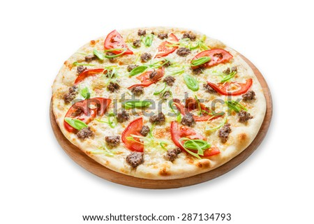 Delicious seafood pizza with tuna fish, tomatoes and leek - thin pastry crust at wooden desk, isolated at white background