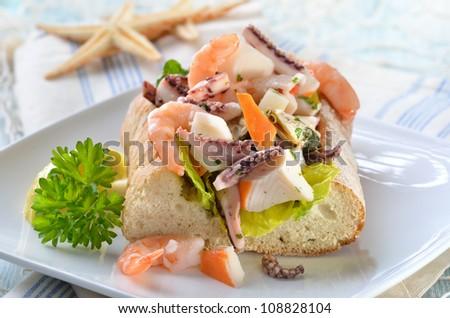 Delicious seafood salad on Italian ciabatta bread - stock photo