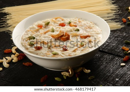 Delicious semiya payasam  is a classic Indian dessert prepared with roasted vermicelli , milk and nuts.Selective focus photograph,