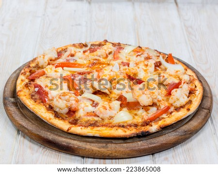 Delicious Shrimp pizza on wood table - stock photo