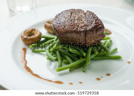 Delicious sirloin steak with green beans