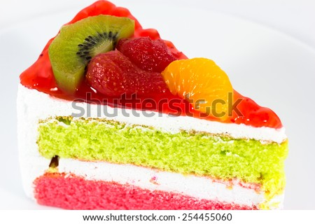 delicious slice of cake on the plate,fruit cake - stock photo