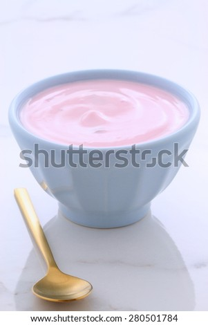 Delicious slow churned Greek strawberry yogurt, with lots of fruit and protein. Perfect for your weight loss program. - stock photo