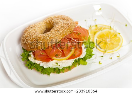 Delicious Smoked Salmon Bagel with Sprouts on a white background. Selective focus. - stock photo