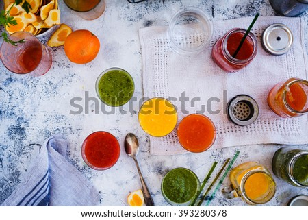 Delicious smoothies for spring, summer on a rustic tabletop. Diet drink concept. Top view. Rustic style. - stock photo