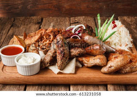 Delicious Snacks For Beer Served With Pita Bread Fried Potato Wedges Onion Rings And