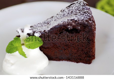 Delicious soft Chocolate Cake. Shallow Depth of Field with Focus on the surface ot the cake. - stock photo