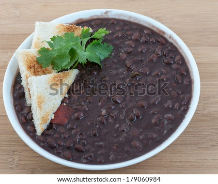Delicious soup of black beans served the Cuban way. Traditional Cuban meal and an important source of vegetable protein in the island - stock photo