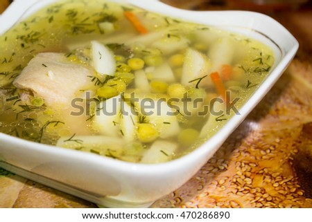 Delicious soup with meat in a square plate