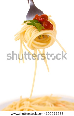 Delicious spaghetti on a fork close-up on white background