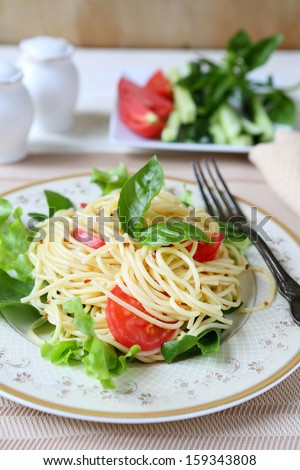 delicious spaghetti with tomato and basil, food close up