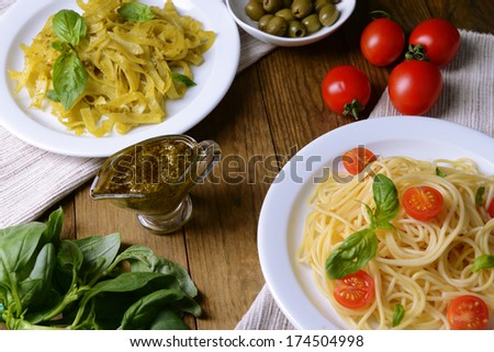 Delicious spaghetti with tomatoes on plate on table close-up - stock photo