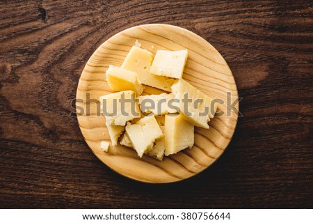 Delicious spanish cheese on a wood board, top view. - stock photo