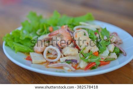 Delicious Spicy Shrimp with Squid Salad (Thai food). - stock photo