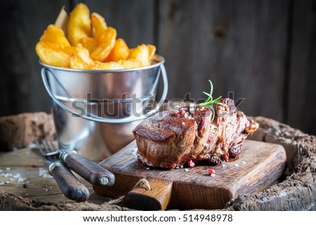 Delicious steak and chips with rosemary and salt