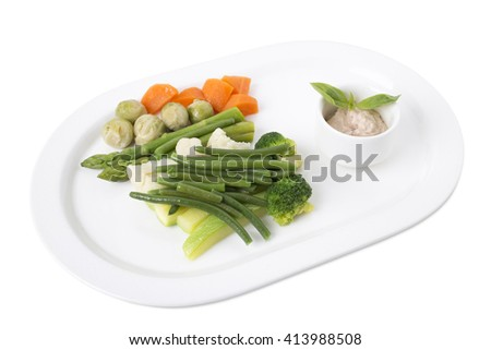 Delicious steamed vegetables with tofu sauce. Isolated on a white background. - stock photo