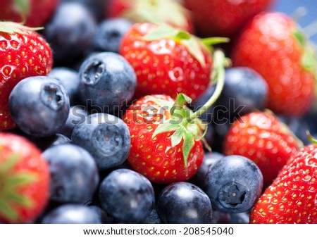 delicious strawberries and blueberries - stock photo