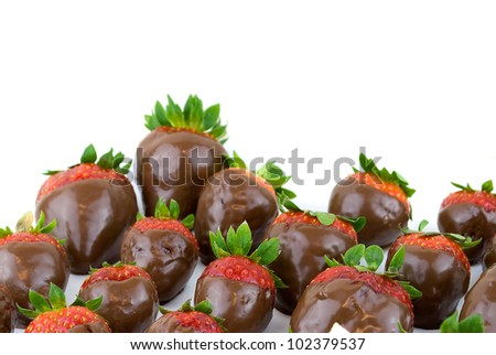 delicious strawberries covered with chocolate in a white plate