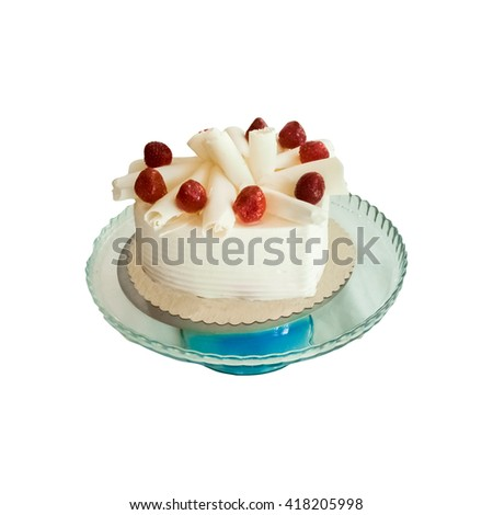 Delicious strawberry cake with white chocolate on a white background - stock photo